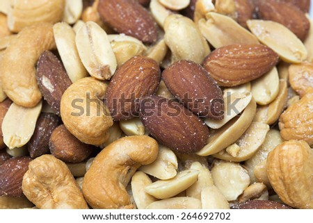Background texture of assorted mixed nuts including cashew nuts, pecan nuts, almonds - stock photo