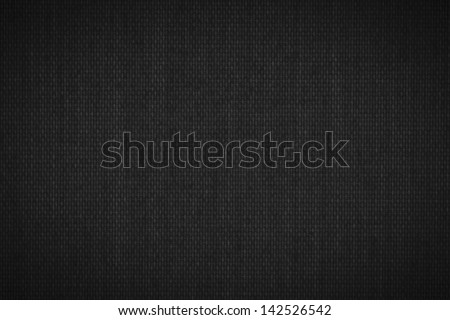 Background texture of dark black fabric closeup with vignette - stock photo