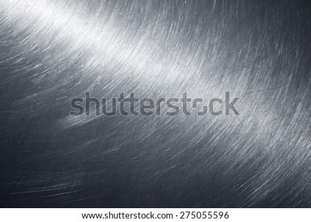 Background texture of shining metal surface with polishing and scratches, selective focus, shallow DOF - stock photo