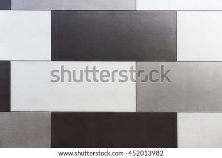 Background texture of tiled panels at the wall. Modern building exterior - stock photo
