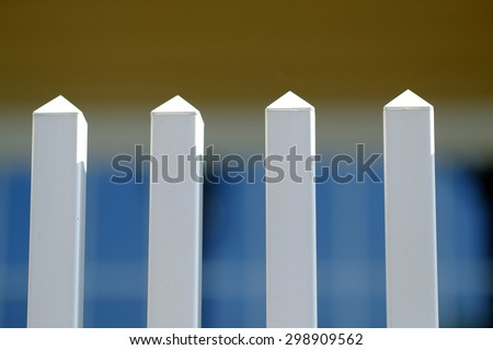 Background, Texture or Abstract: Selective focus on white picket fence. - stock photo
