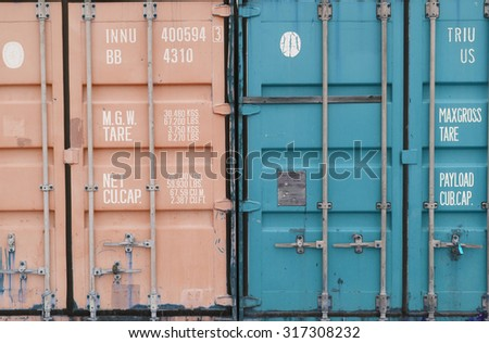 Background texture pattern of stacked white metal shipping containers at freight depot to be shipped to global destinations - stock photo