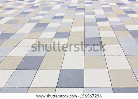 Background texture, tiled pavement city ground - stock photo