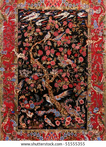 background Turkish silk carpet with floral ornament - stock photo
