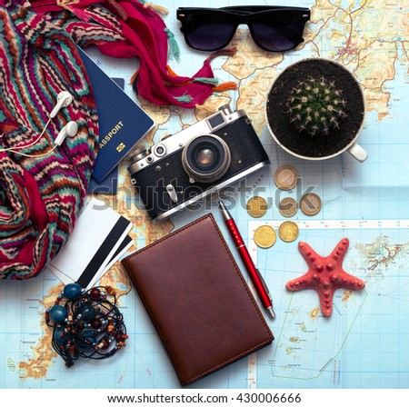 background - what to take for a trip. passport, documents, car keys, map, camera, money, sunglasses, credit cards, accessories - stock photo