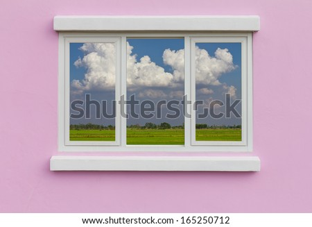 Background window frame in the wall pink blue Cloud backdrop  - stock photo