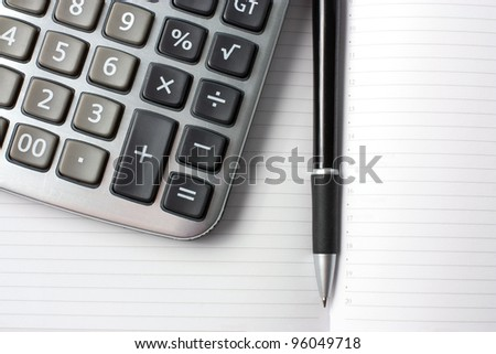 background with a calculator and pen - stock photo