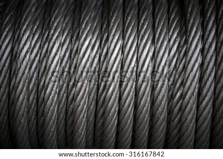 background with a coiled steel cable. - stock photo