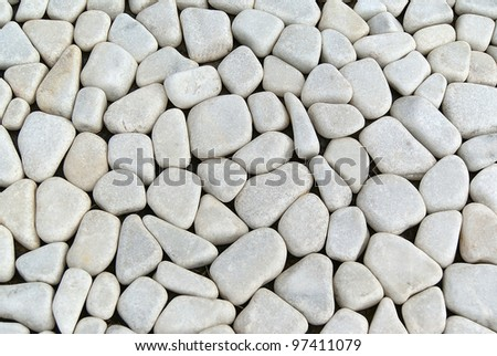 Background with a pattern and texture of ground grey pebbles - stock photo