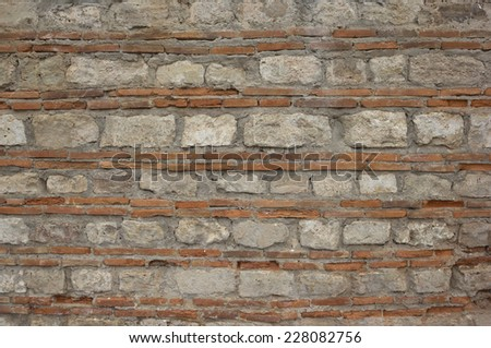 Background with ancient Byzantine masonry - stock photo