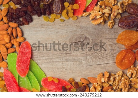 Background with assorted dry fruits and nuts - stock photo