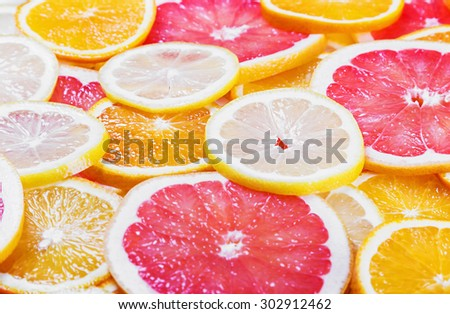 background with citrus-fruit of Fresh fruit slices. Focus at center of frame - stock photo