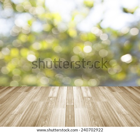 background with empty wooden deck table over winter bokeh blur. - stock photo