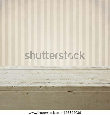 Background with empty wooden table over retro striped wallpaper - stock photo