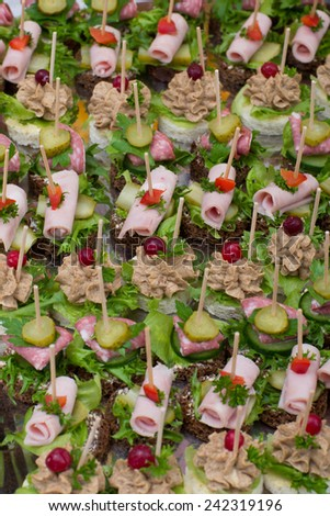 background with festive snack from the big range of canape - stock photo