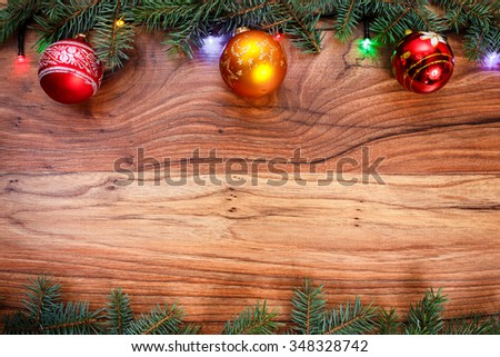 Background with fir branches, toys and colored lights,wooden Christmas background with space for text, card for the winter holidays, xmas, Christmas and New Year