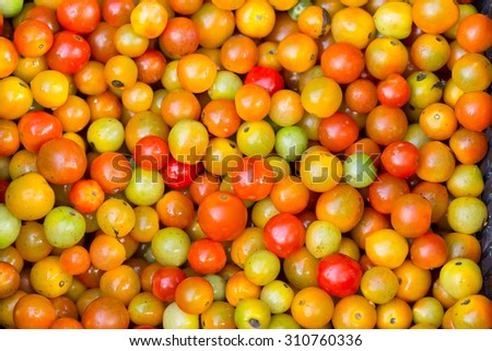 background with fresh red tomatoes in market - stock photo