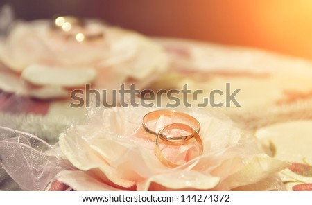 Background with gold wedding rings - stock photo