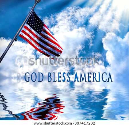 Background with large white clouds against blue sky and reflections in the water. American flag waving and reflection in water.  Patriotic