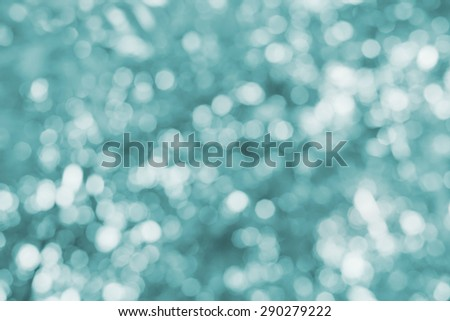 Background with magic bokeh effect, glitter abstract festive backdrop - stock photo