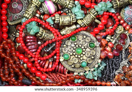 Background with magnificent emeralds and other  jewels - stock photo