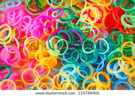 background with many colorful rubber loops - stock photo