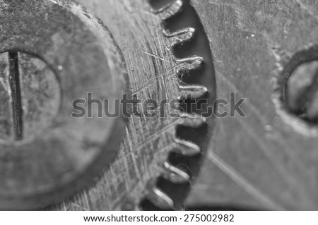 Background with metal cogwheels in old clockwork. Conceptual black and white photo for your successful business  workflow . Macro - stock photo