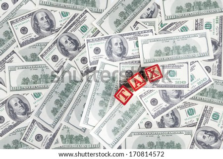 Background with money american hundred dollar bills and TAX - stock photo