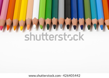 background with multicolored pencils in a row, copy-space - stock photo