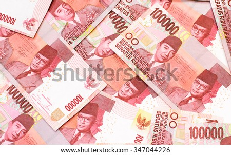 Background with red color of one hundred thousand  Indonesia Rupiah currency,money got profit from business - stock photo