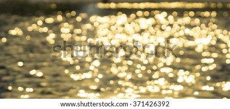 background with reflected lights over water - stock photo