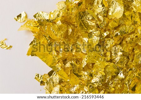 background with scraps of gold foil and empty space - stock photo