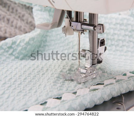 Background with sewing tools and colored fabric