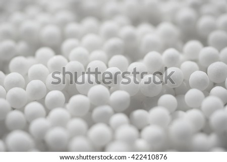 Background with spherical homeopathic pills closeup