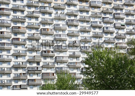 Background with the image of high-rise building with set of balconies