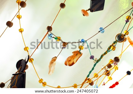 Background with threads and beads close up - stock photo