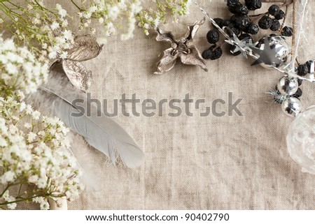 Background with white gypsophila flowers and christmas toys on linen cloth - stock photo