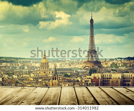 background with wooden deck table and Eiffel tower in Paris - stock photo