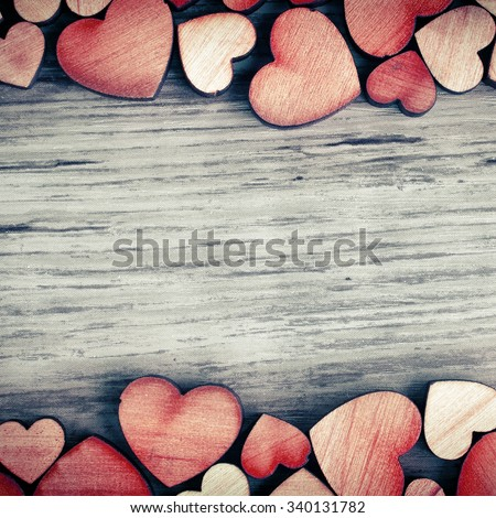 background with wooden  hearts, place for text - stock photo