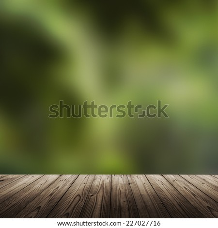 Background with wooden table and blurred green grass - stock photo