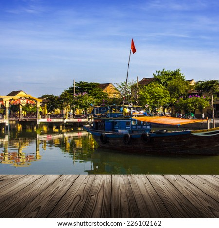 Background with wooden table and Hoi An city, Vietnam - stock photo