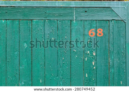 background wooden fence painted green cracked paint