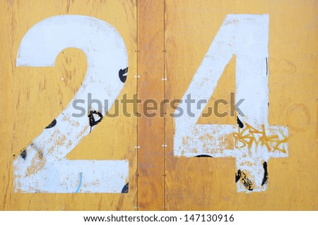 Background yellow pine with a number twenty four 24 - stock photo