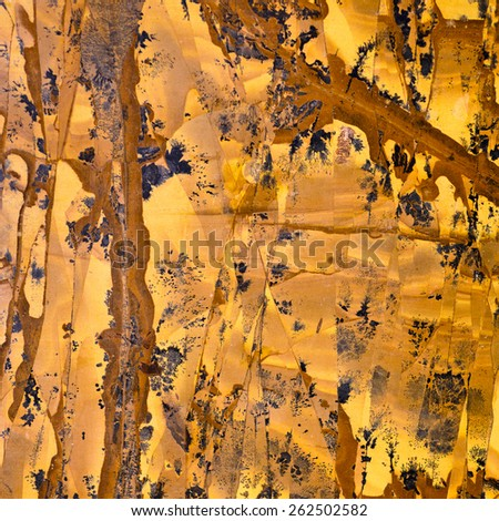 Backgrounds and textures: marble, surface of beautiful orange-yellow decorative stone, abstract pattern of cracks, spots and stains, natural background - stock photo