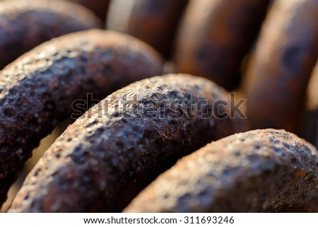 Backgrounds and textures: rusty metal spring surface, selective focus macro shot, industrial abstract - stock photo