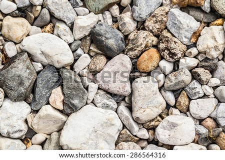 backgroung of rock gravel pebbles of different size and shape - stock photo