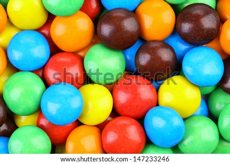 Backgroynd of chocolate balls in colorful glaze. - stock photo