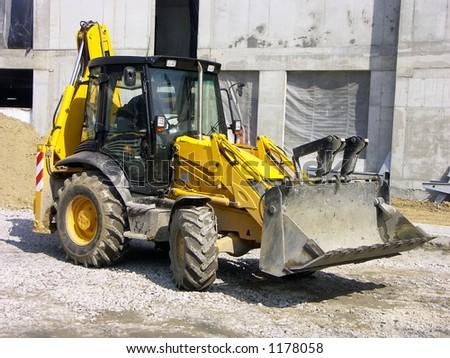 Backhoe loader at construction site - stock photo