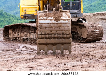 Backhoe running to the street - stock photo