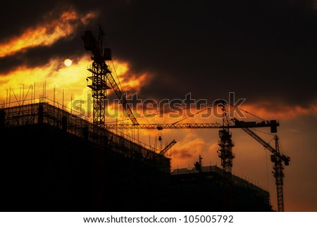 backlight construction site silhouetted at sunset